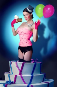 woman coming out of a cake