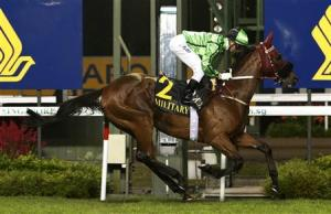 Zac Purton rides Military Attack of Hong Kong to win the SIA Cup horse race at the Singapore Turf Club