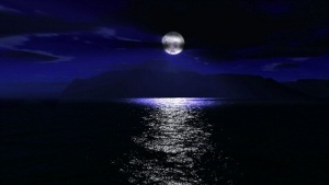 Moon going down over the sea
